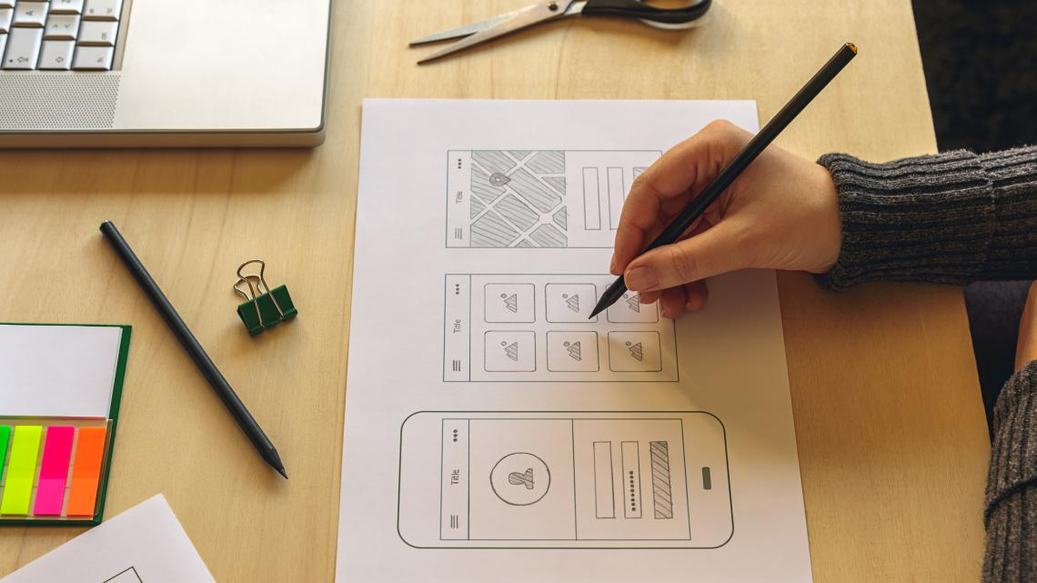 Someone sketching a mobile prototype, published to user experience