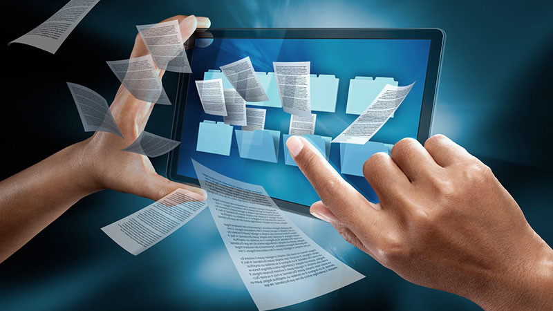 """Hands on a tablet with documents flying, published to """"Docucross, Document Management for the Automotive Sector"""""""