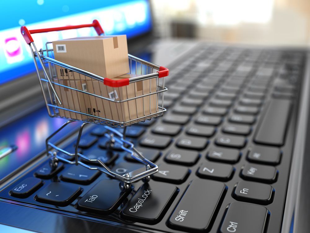 A shopping car on a keyboard, published to NegozYO, The Multichannel E-Commerce Solution For B2B And B2C